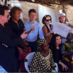 Bono and Rosso Renzo visit a Malian household in Segou.